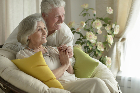 Portrait of a happy senior couple resting at home Stock Photo