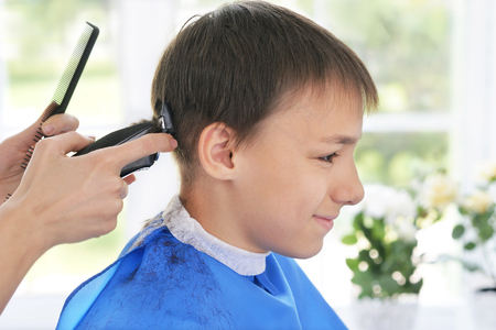 happy client: Portrait of happy client getting haircut from female hairdresser at salon