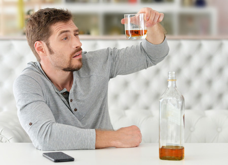 man with whiskey in glass ,alcoholism problem , alcohol abuse concept