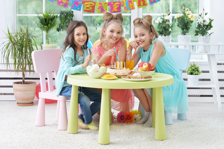 children party: Happy  children with cake at birthday party