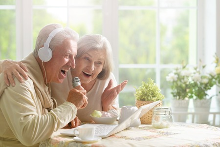 portrait  of Senior couple  and microphone and laptop Stock Photo