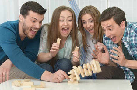 board game: portrait of happy friends have fun together at home