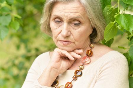 sad old woman: Nice sad old woman on the spring background