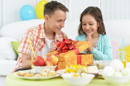 children party: Happy  children  with cake and gift at birthday party Stock Photo