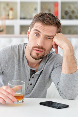 alcohol abuse: man with whiskey in glass ,alcoholism problem , alcohol abuse concept
