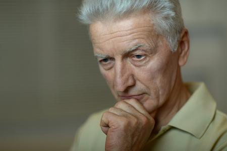 lamentable: Portrait of a sad senior man face
