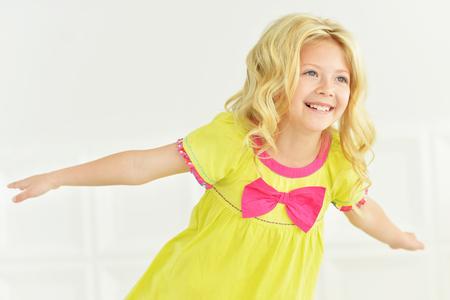 little girl posing: portrait of cute little girl posing in bright dress