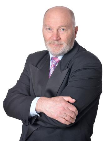 mature business man: Portrait of an elderly businessman on background Stock Photo