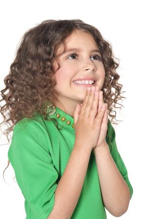 little girl posing: portrait of cute little girl posing in green  dress Stock Photo