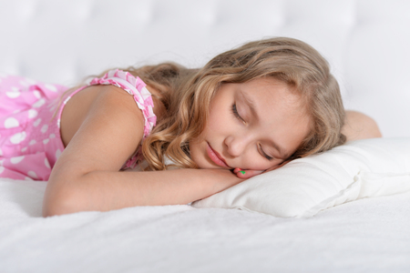 teen girl bedroom: Portrait of a cute little girl sleeping in bed Stock Photo