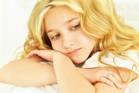 little girl posing: Portrait of a cute little girl posing in white dress