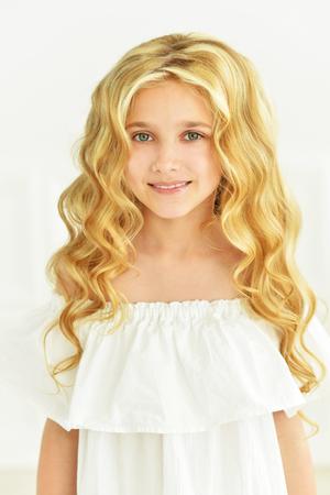 little girl posing: portrait of cute little girl posing in white dress