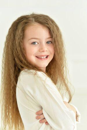 little girl posing: Portrait of a cute little girl posing Stock Photo