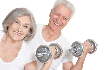 Portrait of Senior Couple Exercising On White Background Banco de Imagens