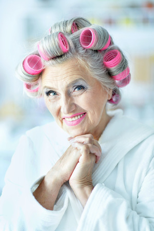 rollers: Senior woman in  hair rollers at home Stock Photo