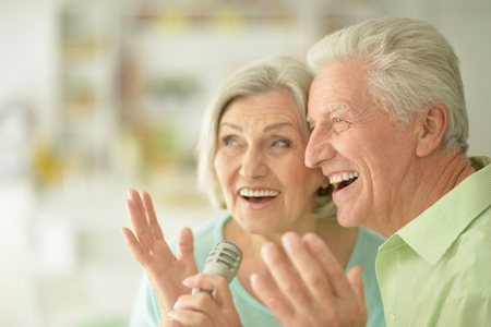 amiable: Portrait of a Senior couple and microphone Stock Photo