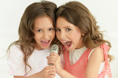 Portrait of a cute girls singing in karaoke Stock Photo