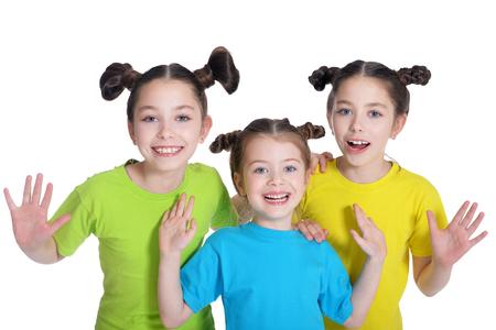 elementary age girls: portrait of cute little girls posing in studio