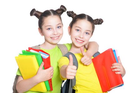 preadolescent: portrait of cute little girls with book posing in studio Stock Photo