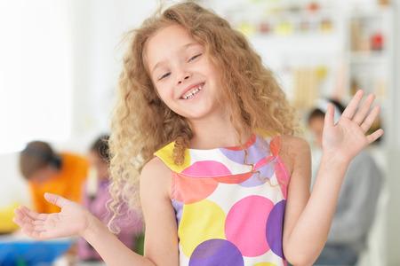preadolescent: portrait of cute little girl posing in beautiful dress