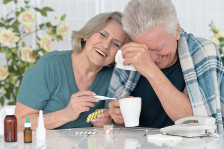 amiable: portrait of  senior couple with pills at home Stock Photo