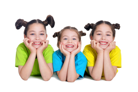 preadolescent: portrait of cute little girls posing in studio