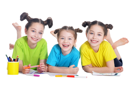 preadolescent: portrait of cute little girls drawing in studio Stock Photo
