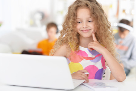 Cute  student girl  with laptop at class