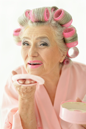 rollers: Senior woman in  hair rollers with powder at home