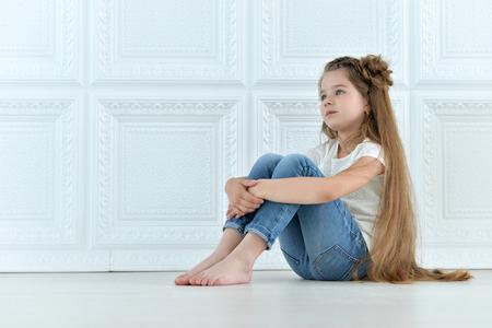 portrait of cute little girl posing in beautiful dress