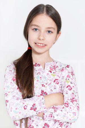 little girl posing: portrait of cute little girl posing in studio Stock Photo