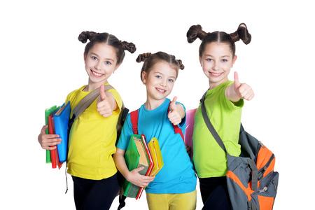 tweens: portrait of cute little girls with book posing in studio Stock Photo