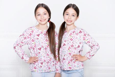 preadolescent: Portrait of a cute little girls posing