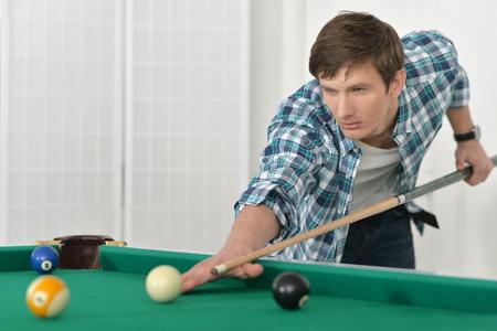 Young man playing billiards in  billiard club Stock Photo