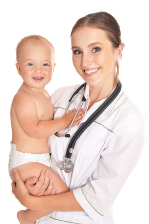 female child: Doctor with child in hospital on a light background Stock Photo