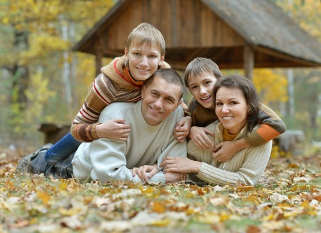 Nice happy family have a walk in the autumn park