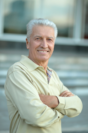 portrait of happy Senior man  in town Stock Photo