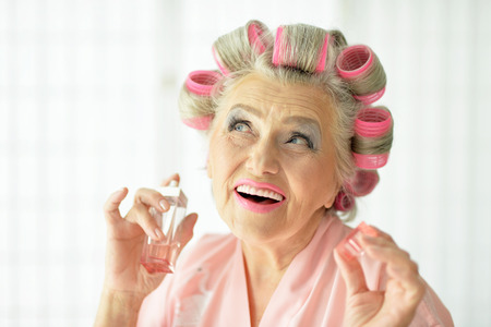 hair rollers: Senior woman in  hair rollers  at home