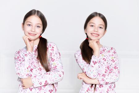 tweens: Portrait of a cute little girls posing