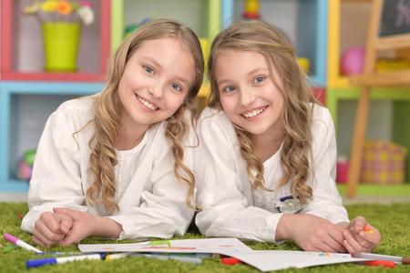 tweens: portrait of Cute girls  on lesson of art