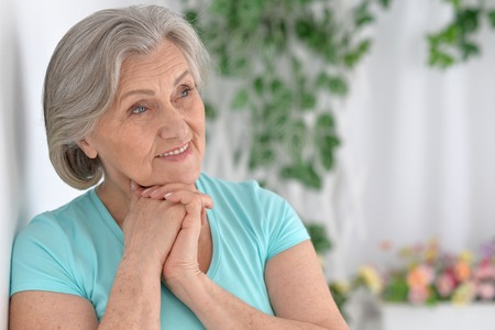 amiable: Portrait of a happy senior woman at home