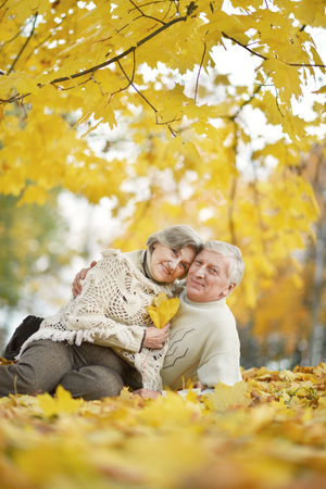 romantic places: Portrait of a happy elderly couple together