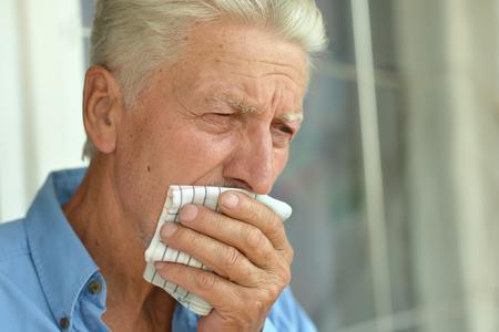 Portrait of a sick elderly man close-up