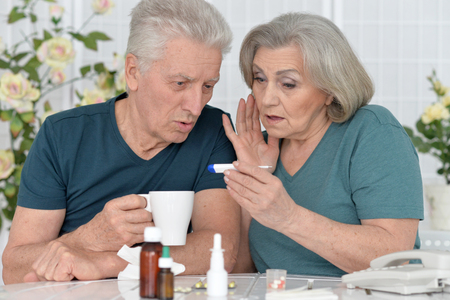 portrait of  senior couple with pills at home Stock Photo