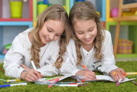 tweens: Portrait of a cute girls on lesson of art