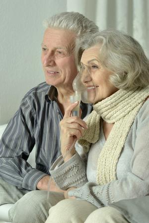 inhalation: Portrait of elderly woman with flu inhalation Stock Photo