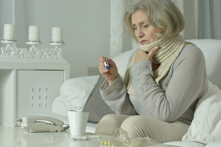 tonsillitis: Portrait of senior woman feel unwell at home