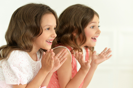 clapping hands: portrait of cute little girls clapping hands Stock Photo