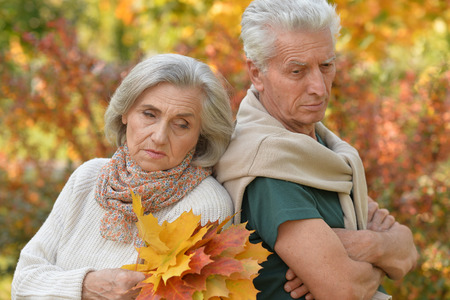 melancholy: Portrait of a sad elderly couple standing  outdoors Stock Photo