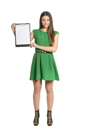 Beautiful woman in green dress with clipboard on white background